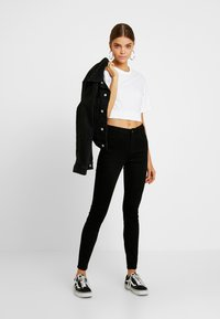 Hollister Co. - HIGH RISE SUPER - Skinny džíny - black clean - 1