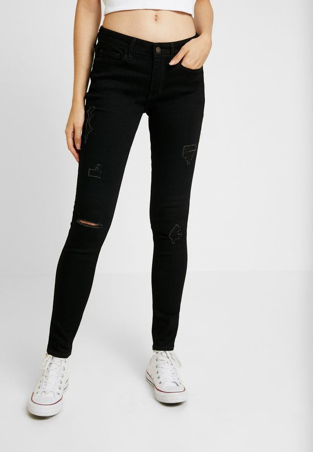 LOW RISE SUPER - Jeans Skinny Fit - black destroyed