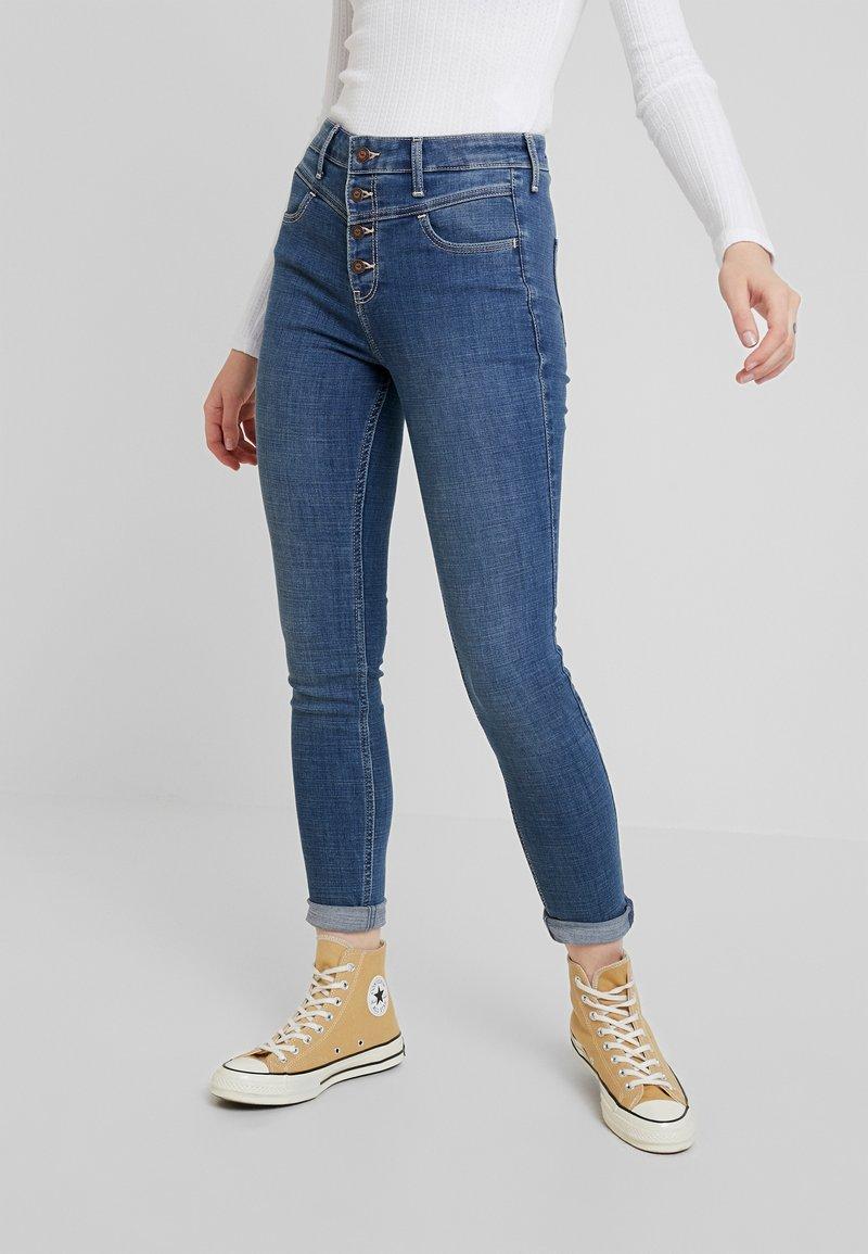 Hollister Co. - HIGH RISE SUPER  - Jeans Skinny Fit - medium yoke shank front