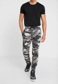 Hollister Co. - ASIA CAPSULE  - Joggebukse - black - 0