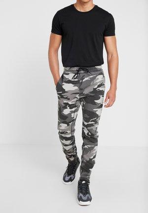 ASIA CAPSULE  - Teplákové kalhoty - black
