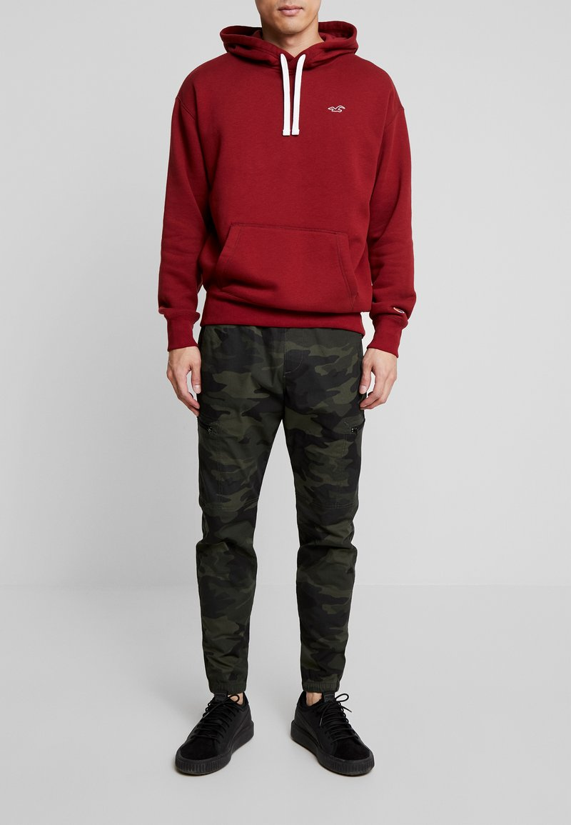 Hollister Co. - UTILITY JOGGER  - Cargo trousers - olive