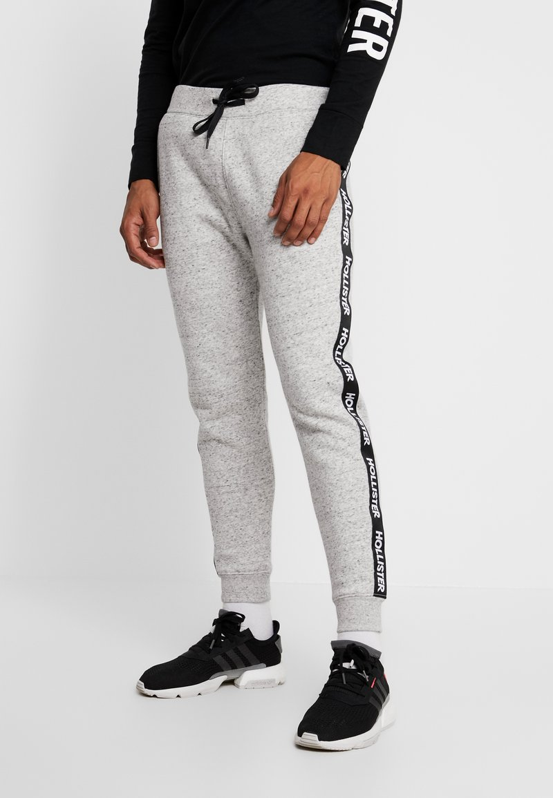 Hollister Co. - TAPE JOGGER  - Tracksuit bottoms - grey