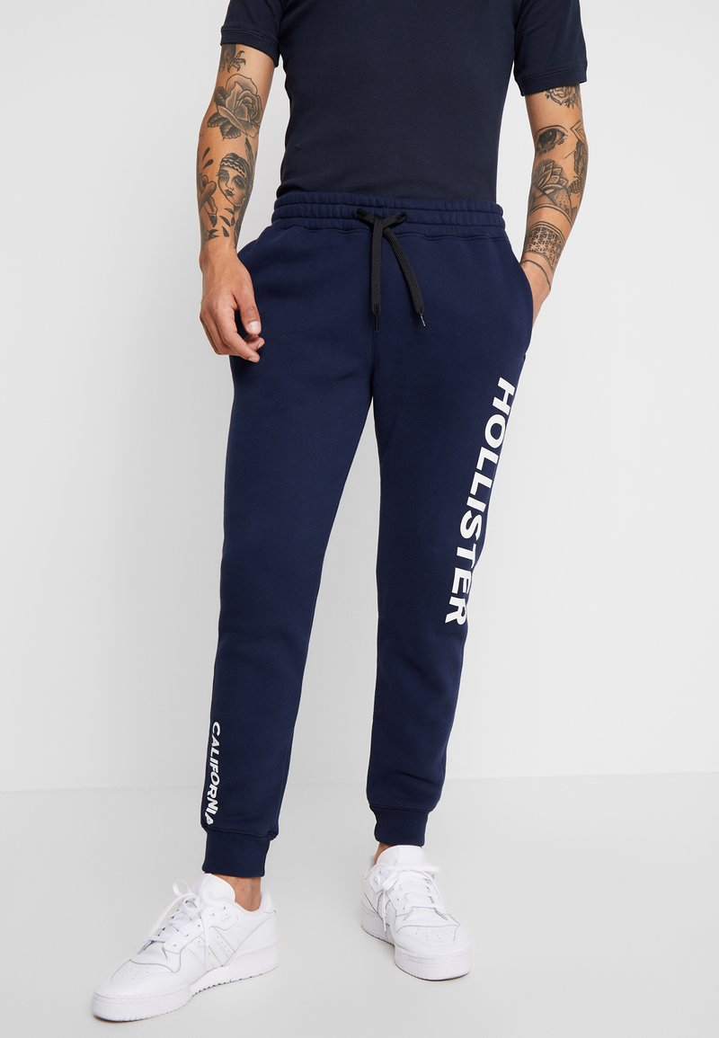 Hollister Co. - SPORT LOGO JOGGER  - Tracksuit bottoms - navy