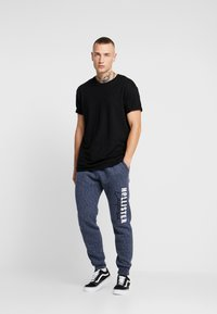 Hollister Co. - Tracksuit bottoms - navy - 1