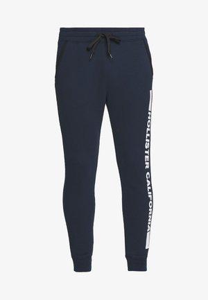 PRINT LOGO - Pantalon de survêtement - navy