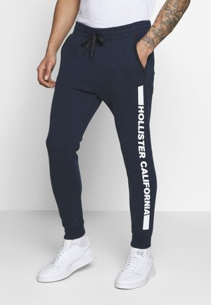 PRINT LOGO - Tracksuit bottoms - navy