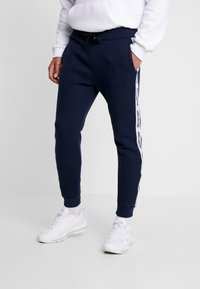 Hollister Co. - TAPE - Pantalones deportivos - navy - 0