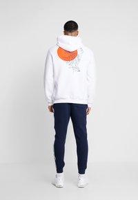 Hollister Co. - TAPE - Pantalones deportivos - navy - 2