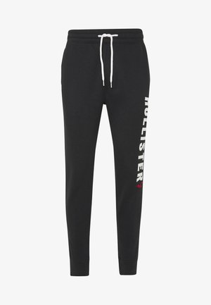 ICONIC LOGO  - Tracksuit bottoms - black
