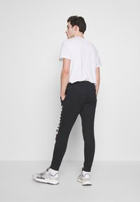 Hollister Co. - ICONIC LOGO  - Tracksuit bottoms - black - 2