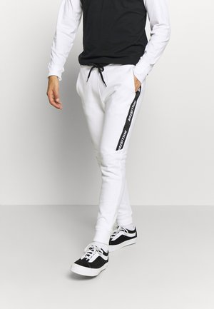 LOGO TAPE JOGGER - Tracksuit bottoms - white