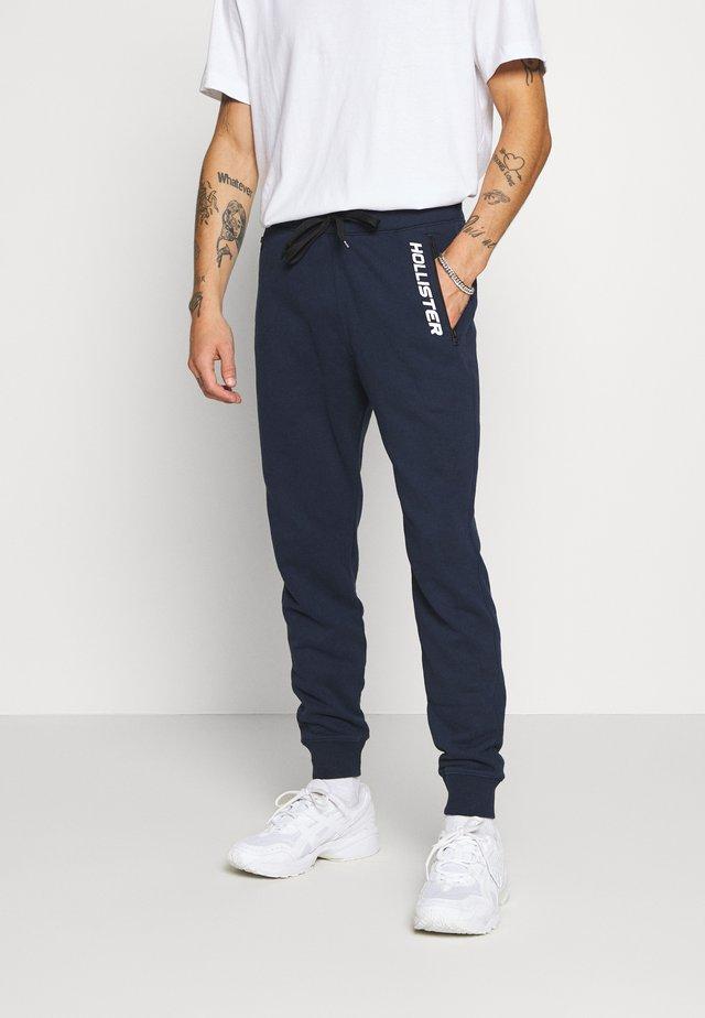 TERRY JOGGER - Pantalones deportivos - navy