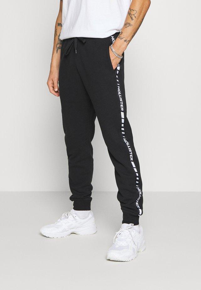 TERRY JOGGER - Pantalones deportivos - black