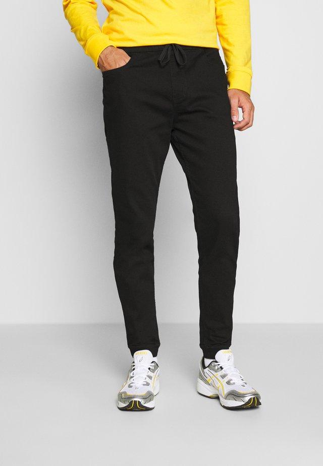 JOGGER NO FADE - Pantalon de survêtement - black clean