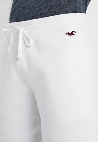 Hollister Co. - FIT - Tracksuit bottoms - white - 3