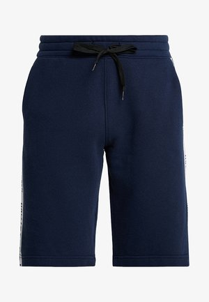 TAPED - Tracksuit bottoms - navy