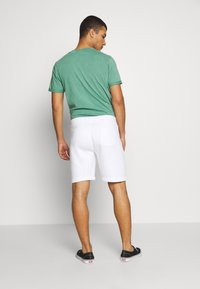 Hollister Co. - SPORT PRINT LOGO - Tracksuit bottoms - white - 2