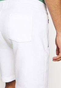 Hollister Co. - SPORT PRINT LOGO - Tracksuit bottoms - white - 3