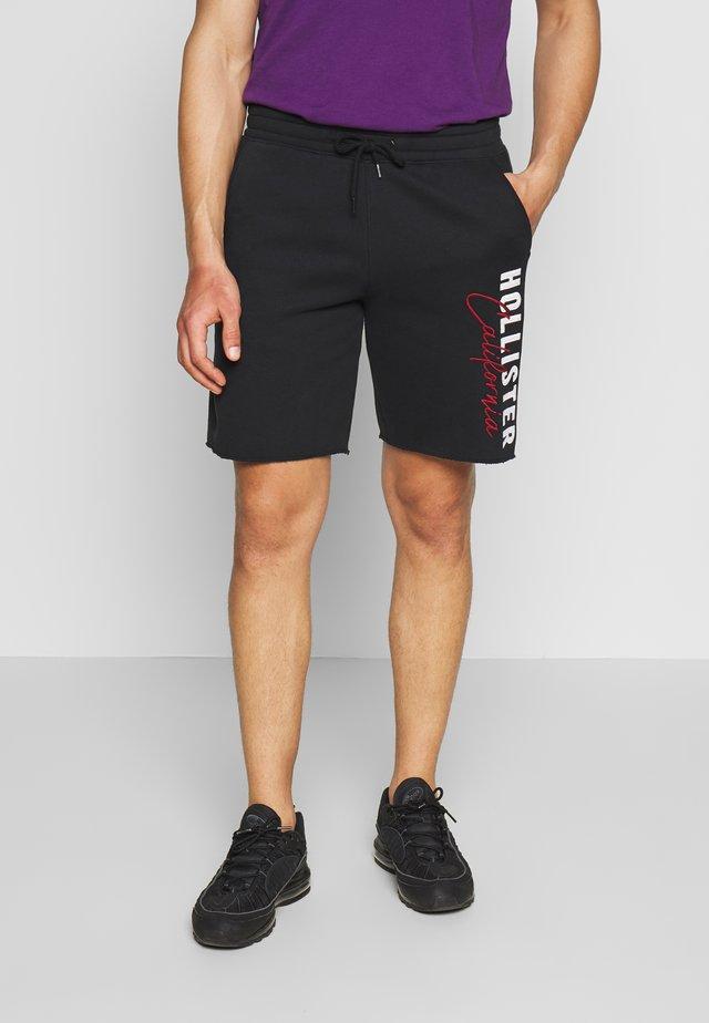 ICONIC LOGO - Pantalones deportivos - black