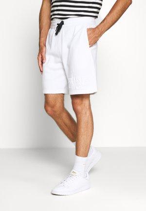 EMBOSS  - Spodnie treningowe - white