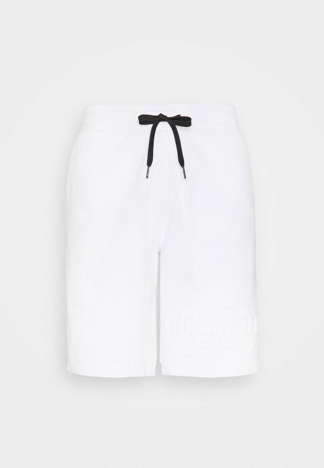 EMBOSS  - Pantalones deportivos - white