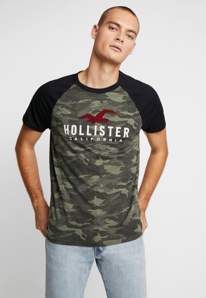 Hollister Co. - RAGLAN CORE  - Triko spotiskem - olive