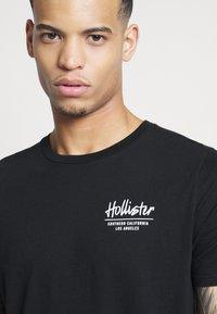 Hollister Co. - T-shirt imprimé - black - 5