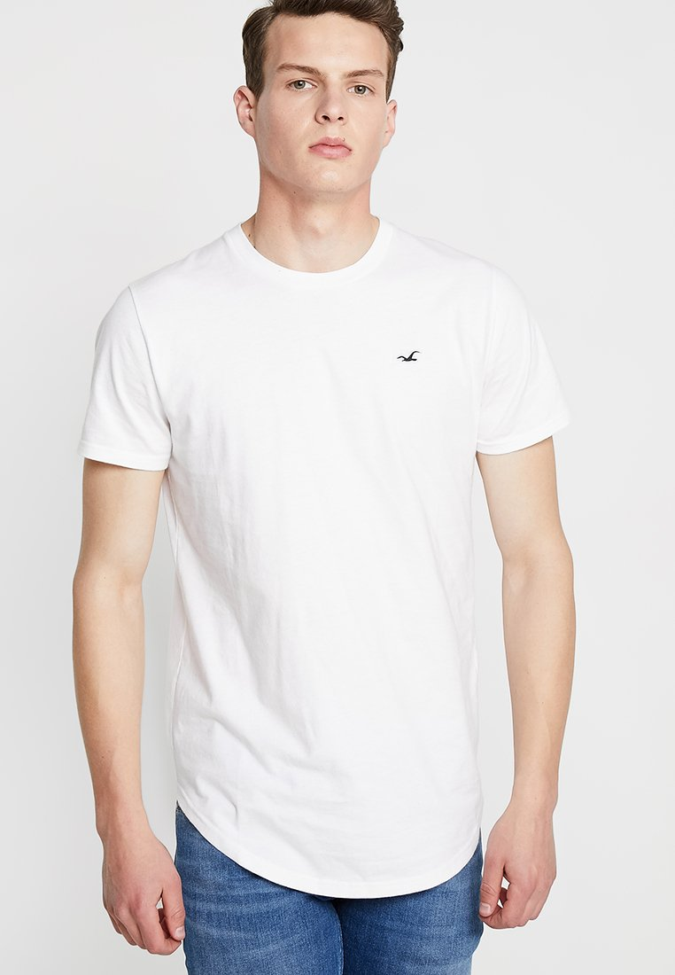 Hollister Co. - CURVED HEM - Basic T-shirt - white