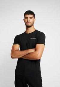 Hollister Co. - WIDE BOX  - Print T-shirt - black - 0