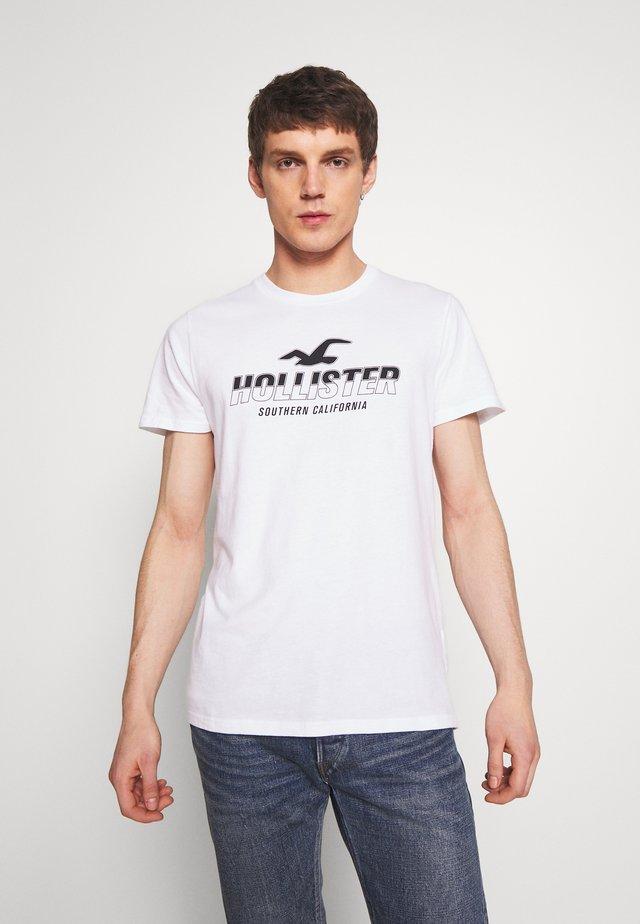 PRINT MOTOSPORT - T-shirt med print - white