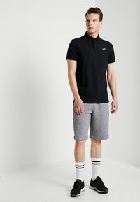 Hollister Co. - HERITAGE MUSCLE SOLID - Polo shirt - black - 1