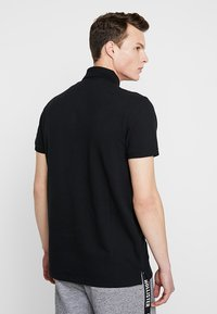 Hollister Co. - HERITAGE MUSCLE SOLID - Polo shirt - black - 2