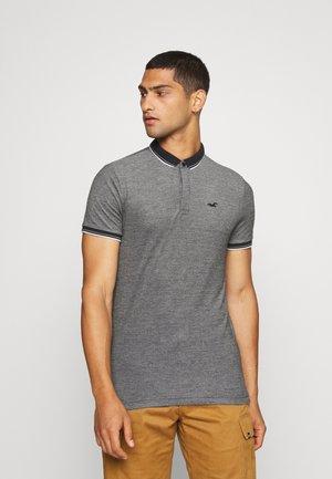 MODERN COLLAR - Polo shirt - textural black/ white tipping