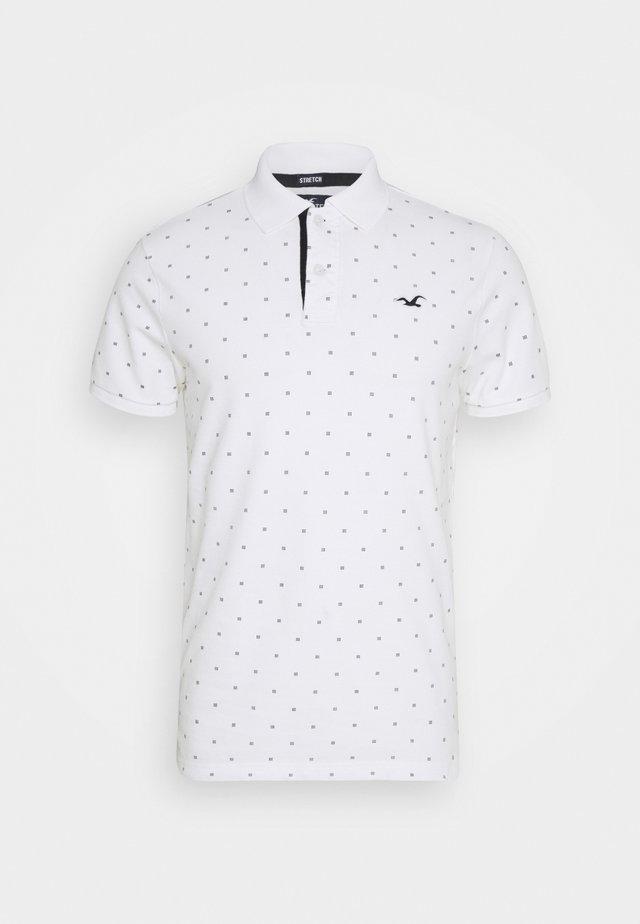 CORE PRINTS - Polo shirt - white