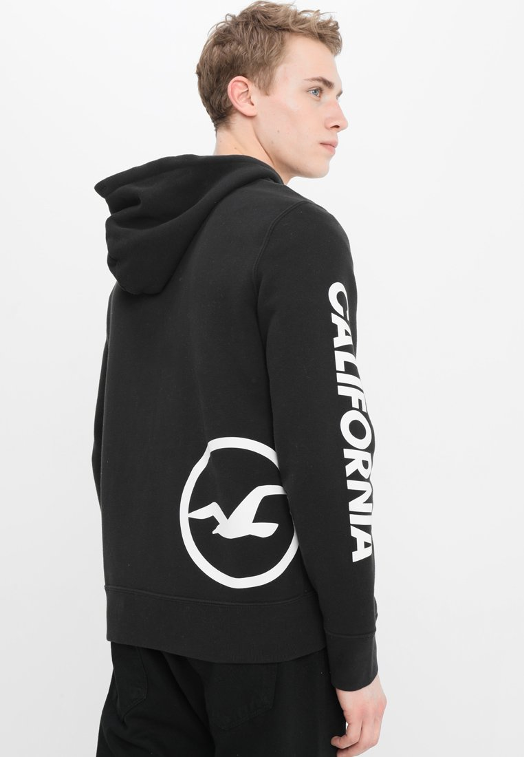 Hollister LogoVeste Sweat Zippée Black En CoPrint iOkZXTPu