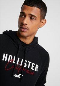 Hollister Co. - TECH LOGO - Hoodie - black - 3