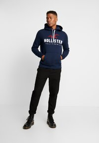 Hollister Co. - TECHNIQUE LOGO  - Mikina s kapucí - navy - 1