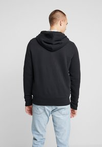 Hollister Co. - TECHNIQUE LOGO - Sudadera con cremallera - black