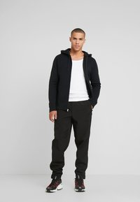 Hollister Co. - GENDERLESS ICON - Zip-up hoodie - black - 1