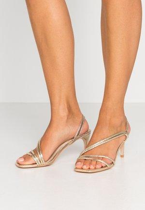 MALACHI - Sandály na vysokém podpatku - gold