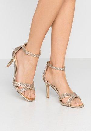 MADIHA - Sandalen met hoge hak - gold metallic