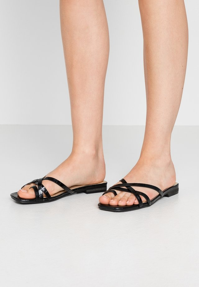 LILLYY - T-bar sandals - black