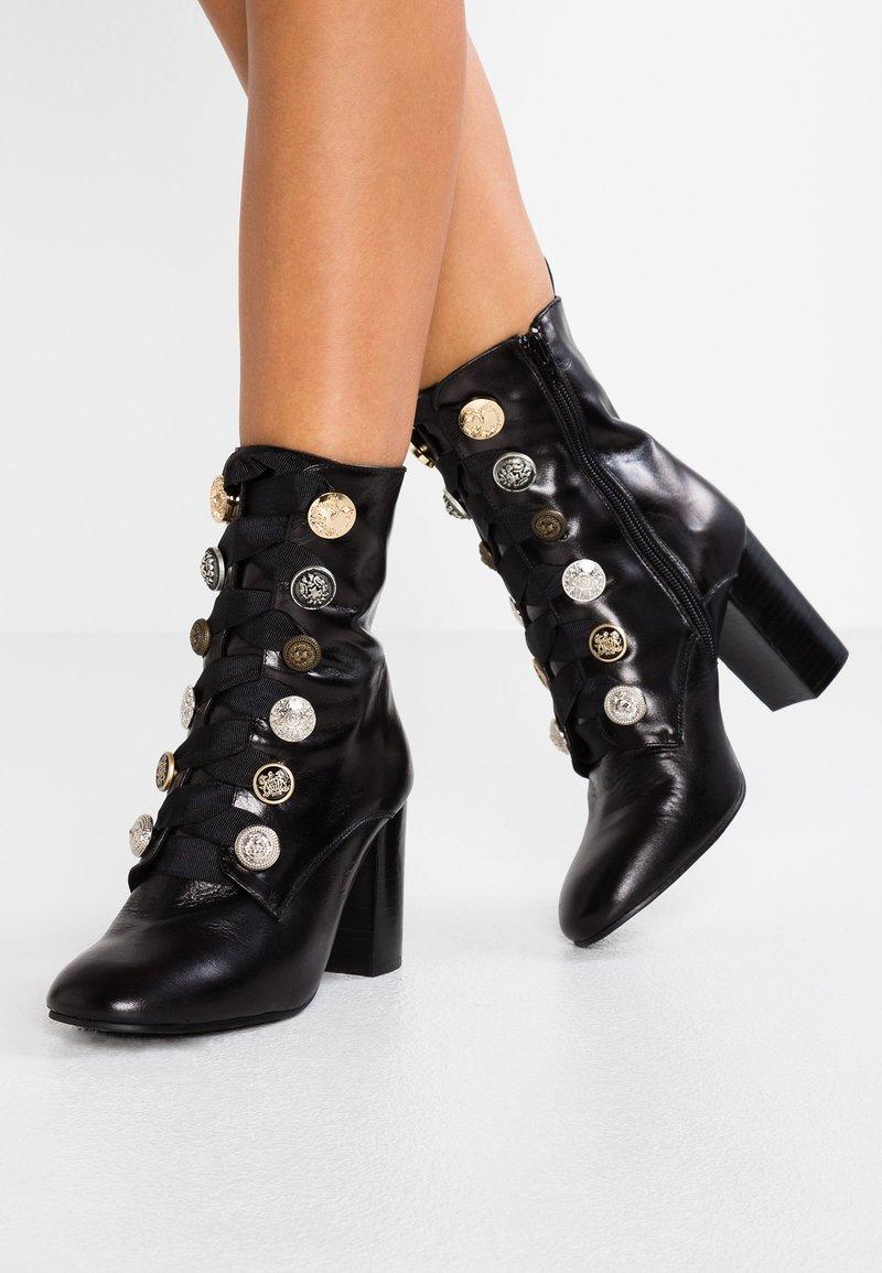 Helia - Šněrovací kotníkové boty - nero