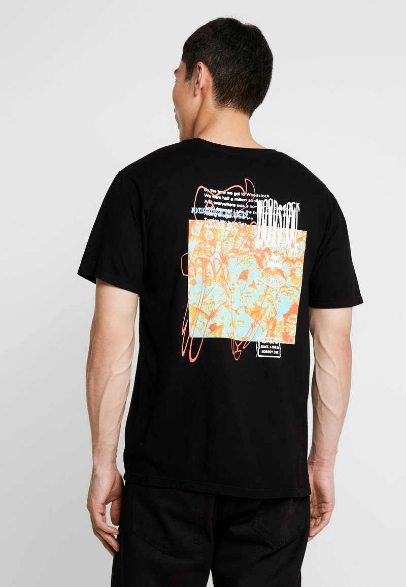 HUF - WOODSTOCK NOBODY CAME TEE - Printtipaita - black