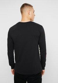 HUF - SHORT POCKET TEE - Camiseta de manga larga - black - 2