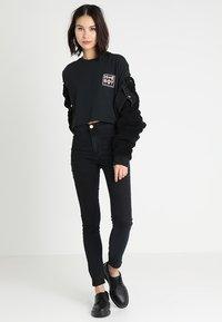 Homeboy - CATE T-SHIRT - T-shirts med print - black - 1