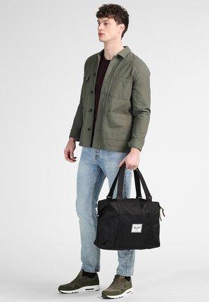 STRAND - Weekend bag - black