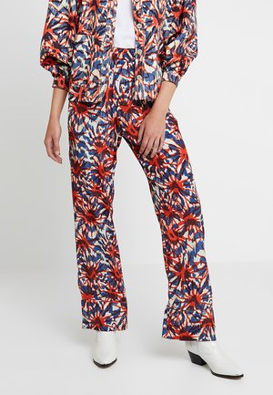 NOMI TROUSERS - Trousers - red/blue