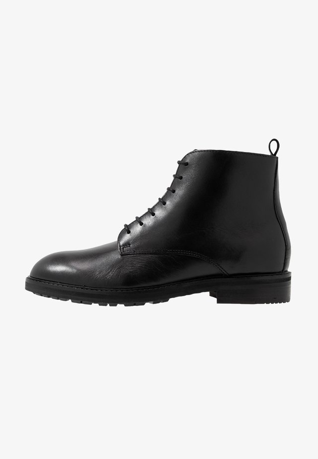 ROWAN TANKER - Lace-up ankle boots - black